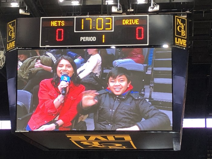 Students participated in answering questions a the Nets game!