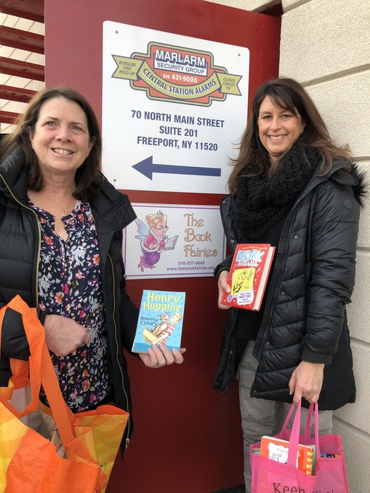 Mrs. Mahland and Mrs. Walsh visit the Book Fairies to fill their classroom library