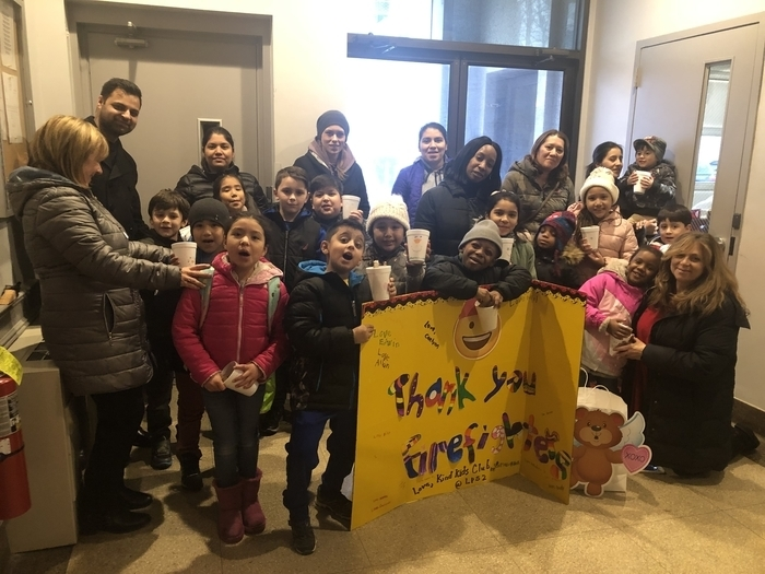 Kind Kids Club & their families at the Inwood Firehouse