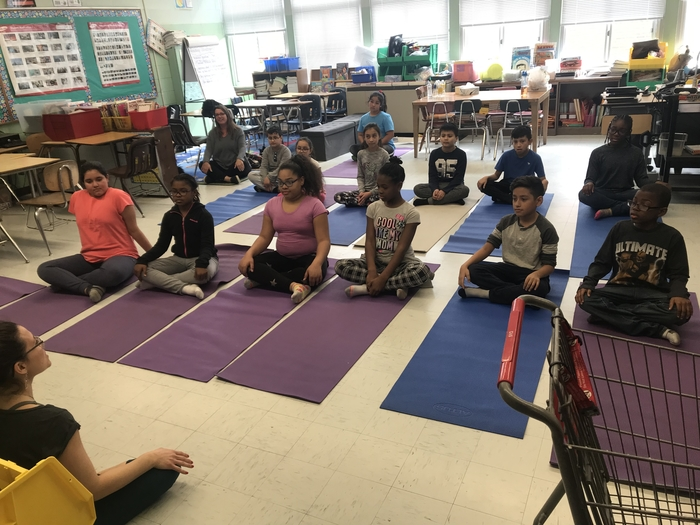 Other learners practicing their mindful breathing