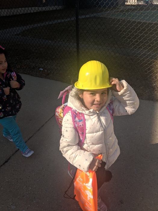 Happily wearing a safety hat