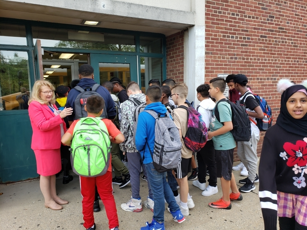 Superintendent Dr. Ann Pedersen greets Middle School students on the First Day of School