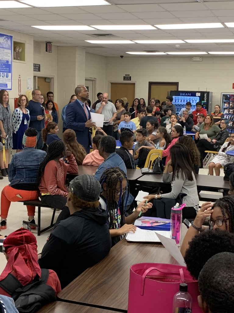 Principal Perry greets parents on Back to School Night on 9/19/19